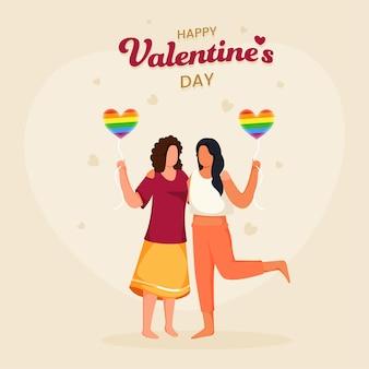 Giovani coppie lesbiche che tengono palloncino cuore bandiera lgbtq