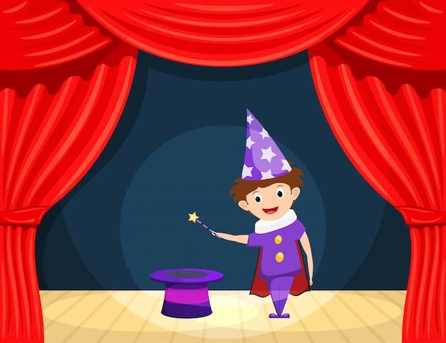 Giovane mago sul palco. spettacolo per bambini. piccolo attore con una bacchetta magica e cilindro sul palco che interpreta il ruolo di un mago.