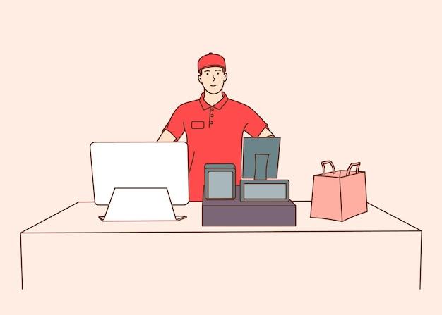 Cassiere di giovane impiegato maschio, lavoratore che utilizza la tecnologia moderna nell'area di lavoro. giovane uomo sorridente registratore di cassa sul posto di lavoro in supermercato, negozio.