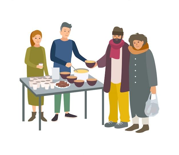 Giovani volontari maschi e femmine che alimentano poveri senzatetto isolati