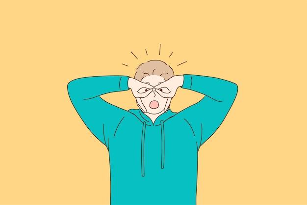 Giovane uomo in felpa con cappuccio verde sensazione pazzo che copre gli occhi con le dita come occhiali su sfondo giallo