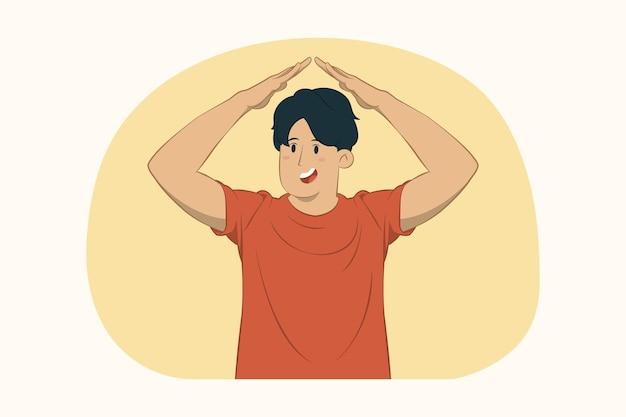 Giovane che tiene le mani piegate sopra la testa come il concetto di tetto