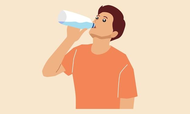 Il giovane sta bevendo l'acqua da una bottiglia