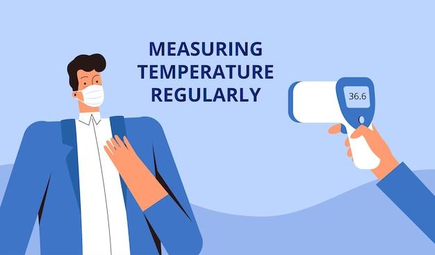 Il giovane in una mascherina medica protettiva misura la temperatura con un termometro a distanza. controlla regolarmente la temperatura. concetto di controllo del corvirus covid-2019.