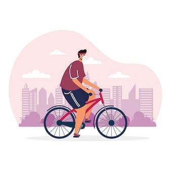 Giovane uomo equitazione sport in bicicletta indossando maschera medica