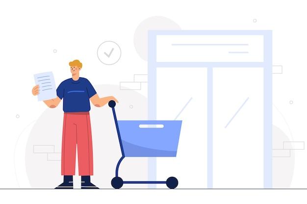 Giovane uomo in piedi con carrello, tiene in mano un elenco di carta nel centro commerciale o nel supermercato