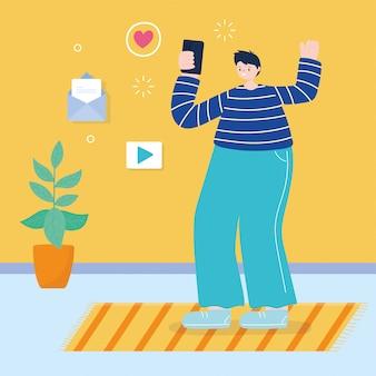 Giovane che utilizza smartphone che pratica il surfing i media sociali nella sala
