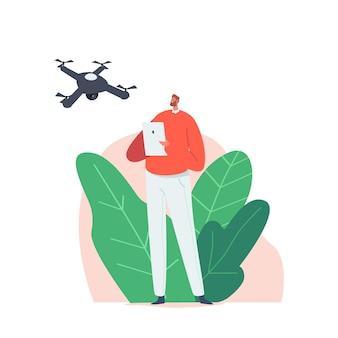 Giovane uomo che guarda e naviga con un drone volante nel cielo. personaggio maschile tieni il tablet pc con l'app per il telecomando
