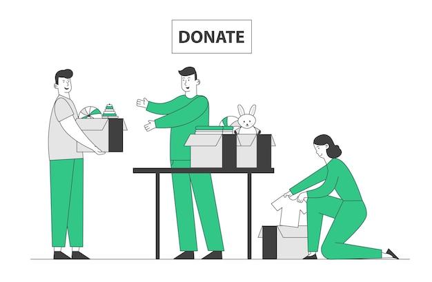 Volontari altruistici del giovane e della donna che raccolgono vestiti