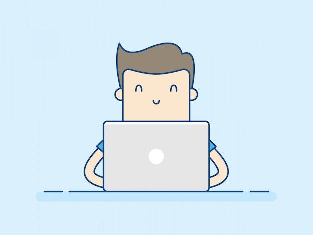 Giovane che lavora con il computer portatile.