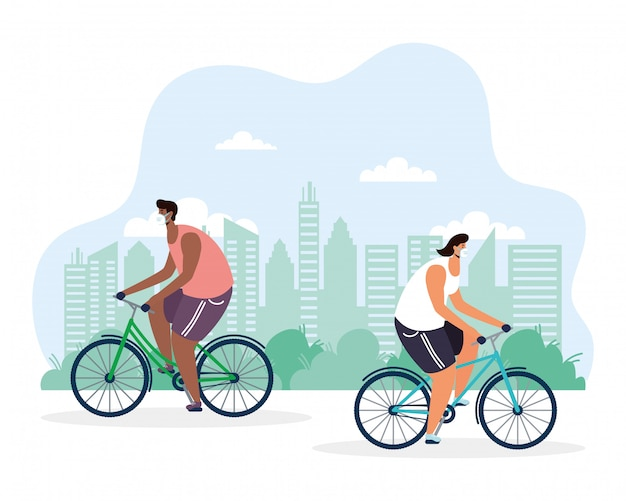 Giovani uomini in bicicletta che indossa la maschera medica