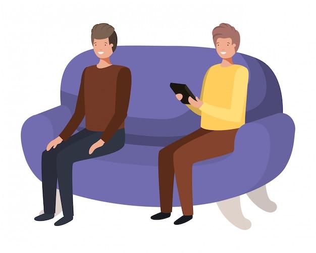 Giovani uomini seduti sul divano con il personaggio avatar