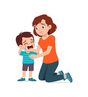 La giovane madre abbraccia un ragazzino piangente e cerca di confortarlo