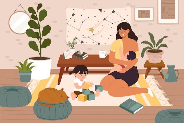Una giovane madre trascorre del tempo con il neonato e la figlia