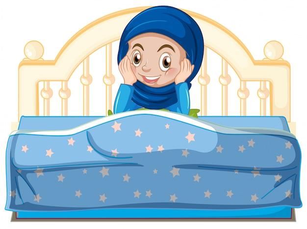 Una giovane ragazza musulmana a letto