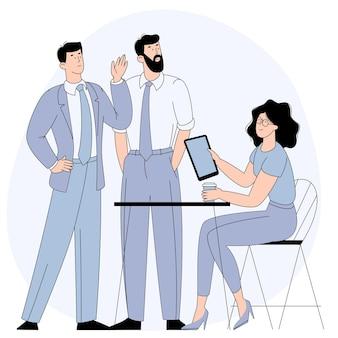 I giovani uomo e donna che prendono parte alla trattativa di riunione d'affari