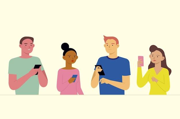 Giovani che usano gli smartphone