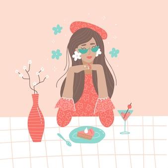 La giovane bella donna che si rilassa al bar mangia una torta e beve un cocktail romantica ragazza single s...