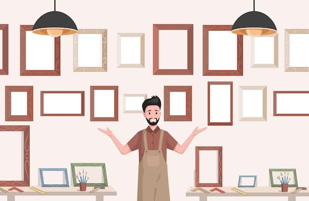 Giovane uomo sorridente in grembiule che vende cornici per quadri