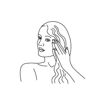 Una giovane donna si applica una maschera ai capelli silhouette minimalista astratta della ragazza di linea