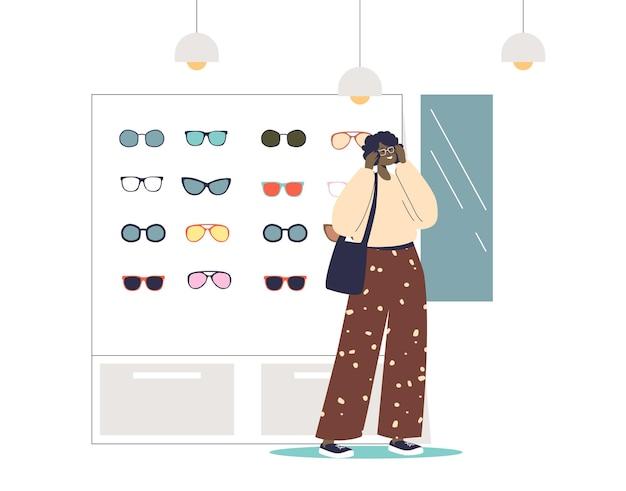 Giovane donna che sceglie gli occhiali da sole nell'illustrazione moderna del negozio di ottica