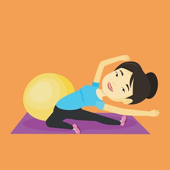Giovane donna che si esercita con fitball.