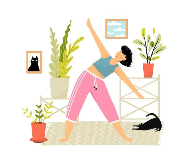 Giovane donna a casa facendo esercizi sportivi