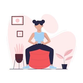 Una giovane donna sta facendo un esercizio con fit ball stile di vita sano in quarantena attività domestiche