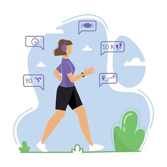 Una giovane donna è impegnata a camminare all'aria aperta una donna indossa un fitness tracker