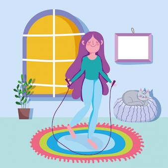 Esercizio di sport di attività della corda di salto della giovane donna a casa