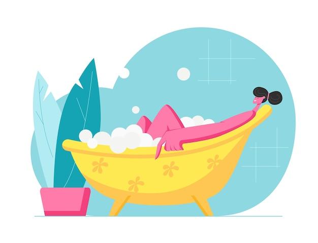 Giovane donna che si distende nella vasca da bagno con le bolle in hotel spa oa casa. procedura di igiene e bellezza personaggio femminile felice