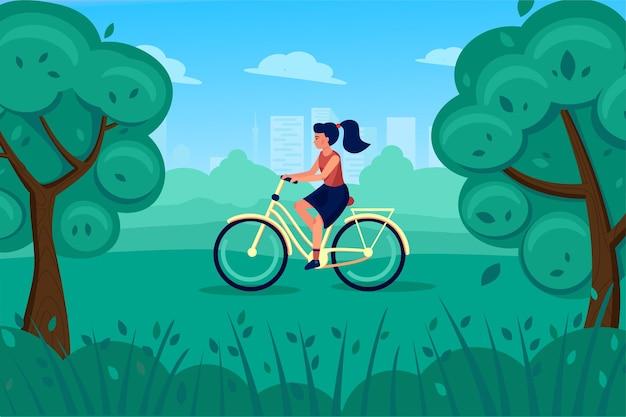 Giovane donna su una bicicletta retrò cavalca attraverso lo sfondo del parco