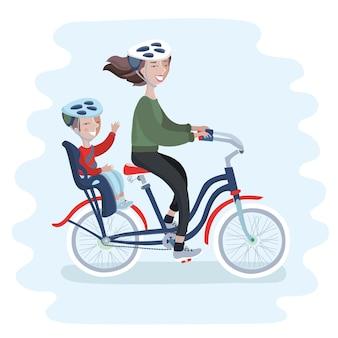 Giovane donna in bicicletta con il suo bambino carino nel seggiolino per bicicletta.