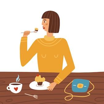 Giovane donna seduta al tavolino di un bar mangiando cupcake e bevendo caffè personaggio femminile a pranzo...