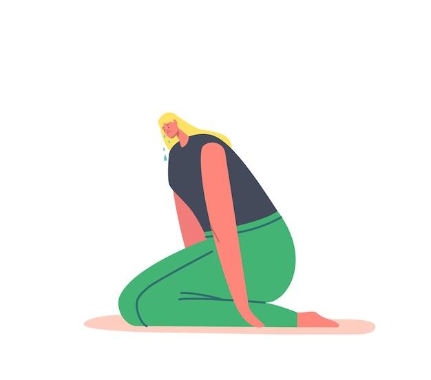 Giovane donna seduta sul pavimento che piange, sente dolore e lutto con lacrime che scendono, donna triste esprime emozioni negative