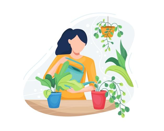 Giovane donna che prende cura delle piante