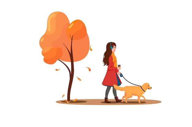 Una giovane donna cammina con un cane nel parco