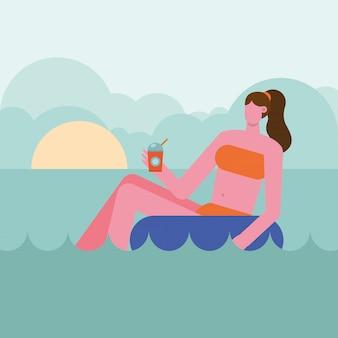 Costume da bagno da portare della giovane donna che si distende nel carattere del galleggiante