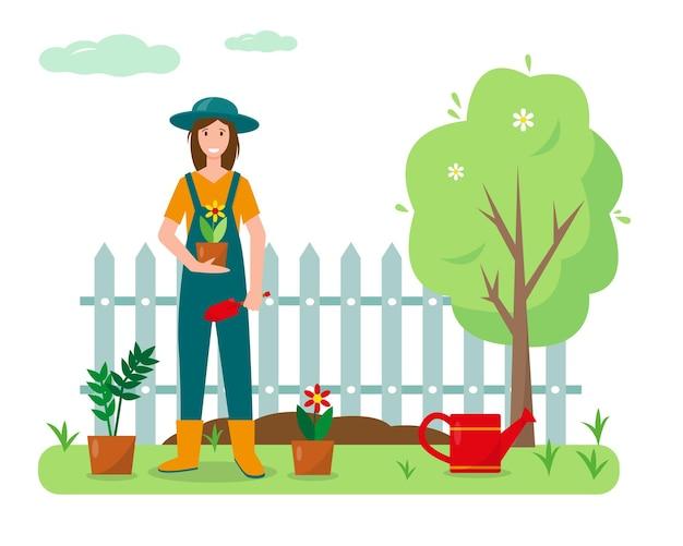 Giovane donna con fiori e attrezzi da giardinaggio in giardino. progettazione del concetto di giardinaggio. banner di primavera o estate.