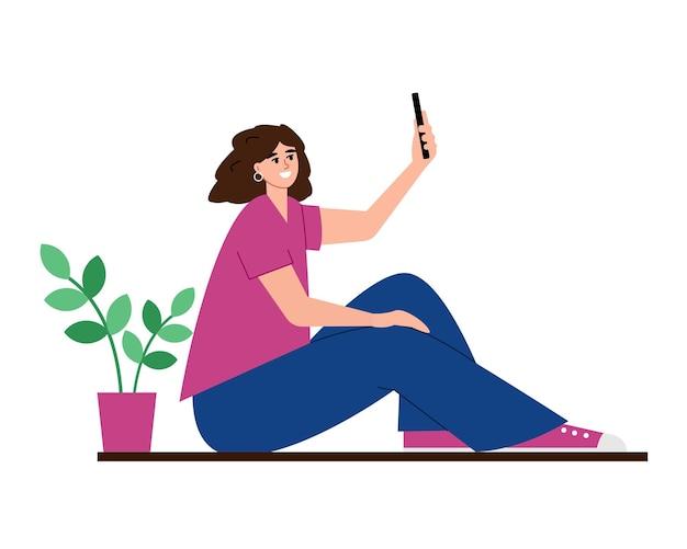 Giovane donna con smartphone che prende selfie isolato