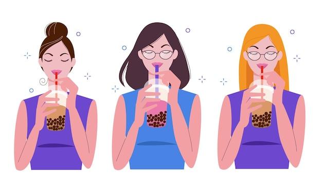 Le giovani donne bevono tè al latte con bolle, bevanda popolare taiwanese boba con perle nere di tapioca