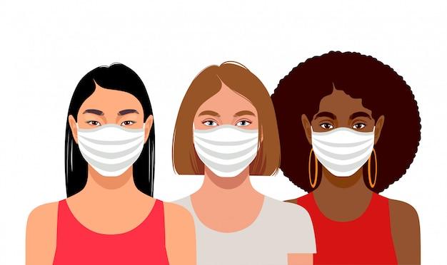 Giovani donne che indossano maschere protettive