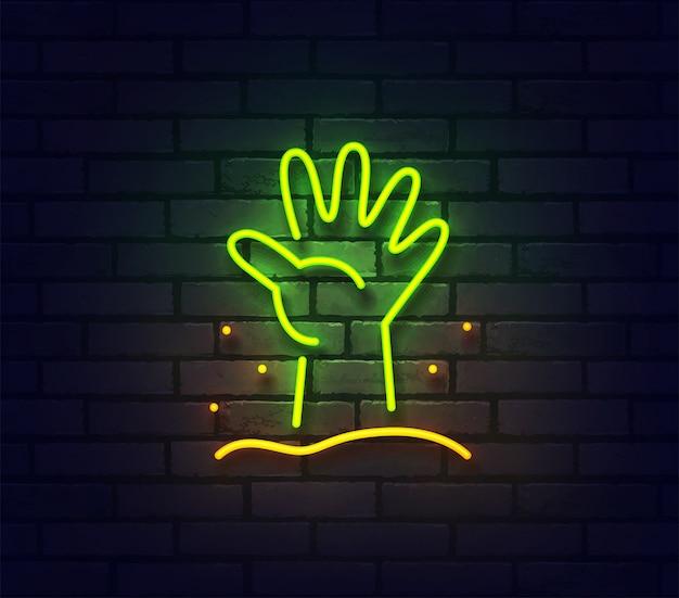 Insegna al neon della mano di zombie. insegna luminosa al neon sul muro di mattoni.
