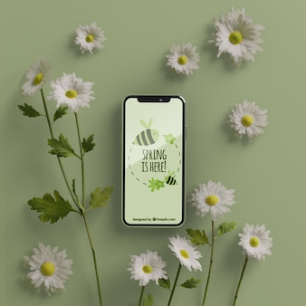 3d bloemen rond mobiel op tafel
