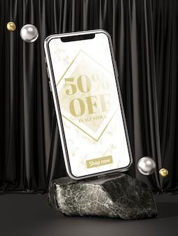 3d maqueta teléfono inteligente sobre roca de mármol