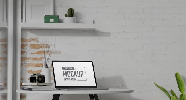 3d-rendering draagbare werkruimte met laptop