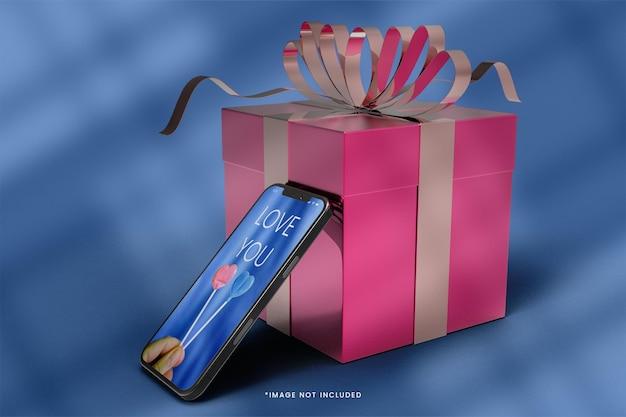 3d-smartphone en geschenkdoos mockup