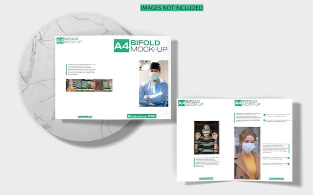 A4 tweevoudige brochure mockup op marmeren bovenaanzicht