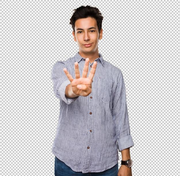 Adolescente que hace el número cuatro gesto