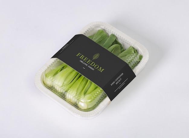 Afhaalmaaltijden container ronde doos mockup met groente Premium Psd